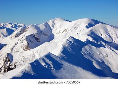 Peaks of Tatra Mountains in winter seen from Kasprowy Wierch