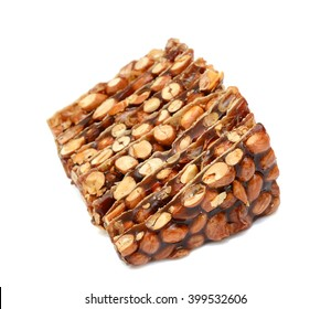 Peanut brittle candy isolated on white background