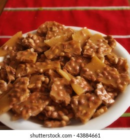 Peanut brittle candy on a plate