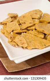 peanut brittle served on double stacked plates. This peanut brittle is made with peanuts from the state of Georgia.