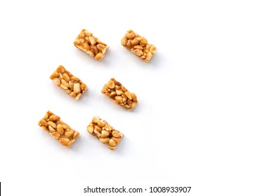 The peanut brittle snack candy six pieces on isolated white background