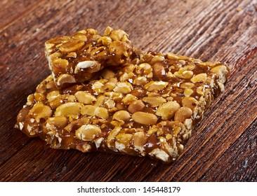 Peanut brittle sweet hard on wooden table