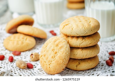 peanut butter cookies with glasses of milk on a wood background. the toning. selective focus