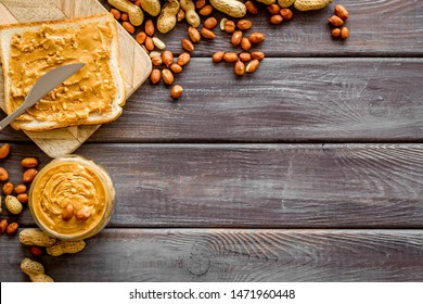 peanut butter for cooking breakfast with sandwiches at home on wooden background top view mock-up