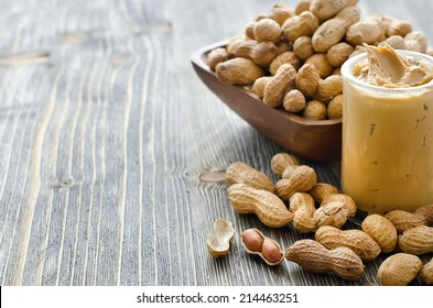 Peanut butter copy space sample text wooden background selective focus
