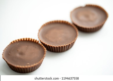 Peanut butter cups shot on a white background macro