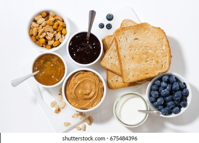 peanut butter, jams and toasts for breakfast, top view, horizontal