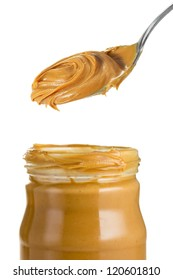 Peanut butter in jar with spoon