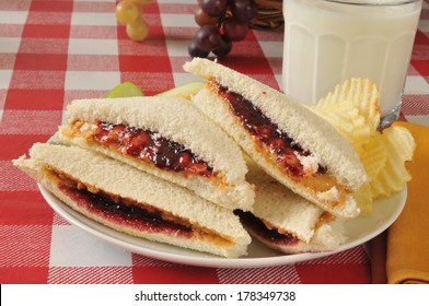Peanut butter and jelly sandwich with the crust trimmed off
