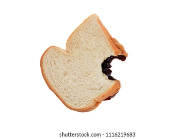 peanut butter and jelly sandwich on white bread with bite missing isolated white background