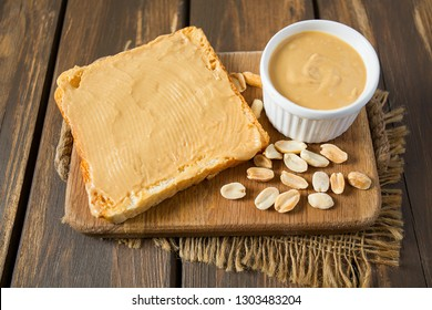 Peanut butter sandwich on wooden surface
