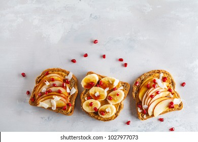 Peanut butter sandwiches with apple banana and pomegranate background. Food background, copy space, top view.