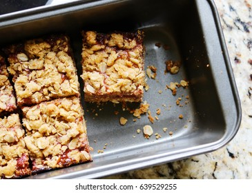 Peanut Butter and Strawberry Jelly Oat Bar Squares in a Baking Pan