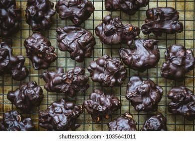 Peanut, cherry, chocolate clusters arranged on grid