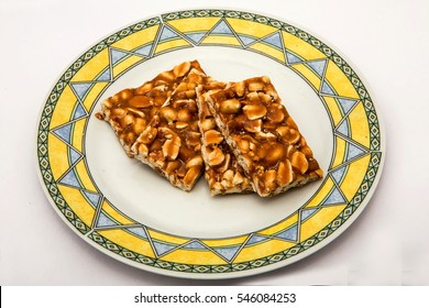 Peanut chikki or peanut brittle is a delicious candy. Easy to made at home. It;s a traditional sweet preparation across India and is usually made by jaggery and peanuts or ground nuts blended together