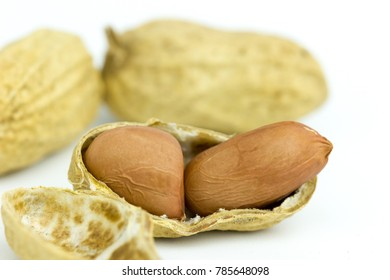 Peanut seed is placed on a white background.