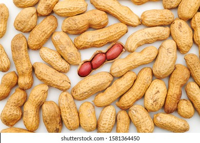 Peanuts background with one opened peanut nutshell containing three peanuts. In a nutshell concept. Nuts nutrition for an healthy and balanced long life. Openness concept. Transparence concept