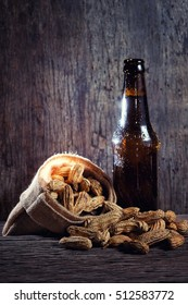 Peanuts and Beer bottle in wood background