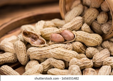peanuts in bowl isolated on retro background.