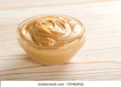 peanuts butter on a wooden background