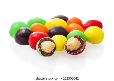 Peanuts covered with multicolored glaze on a white background