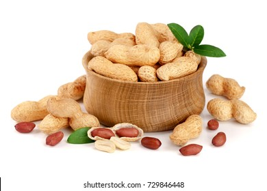 peanuts with leaf in wooden bowl isolated on white background