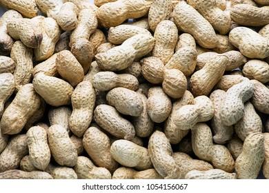 Peanuts in nutshell background