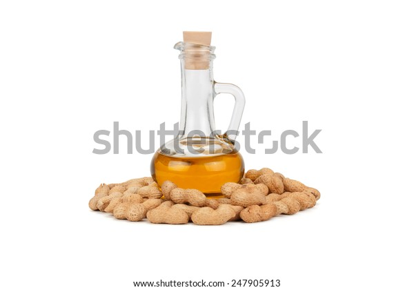 peanuts and oil in bottle isolated on white background