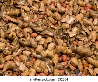 Peanuts and smashed peanut shells background.