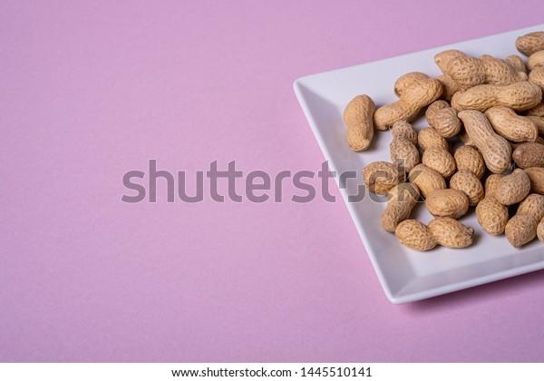 Peanuts White Square Shaped Plate Minimal Stock Photo Edit