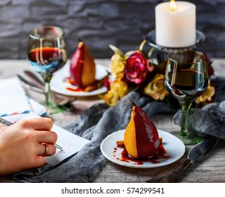 Pear be-color. Romantic atmosphere. Pears in wine. Wine glasses