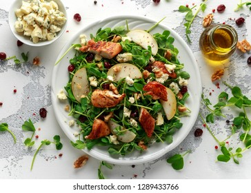 Pear, chicken salad with blue cheese, cranberry and walnuts. concept healthy food