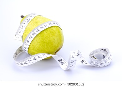 Pear and measuring tape isolated on white
