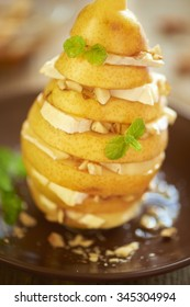 Pear mille feuille with camembert, chopped almonds and honey