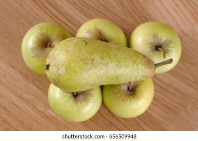 A pear on a apples.