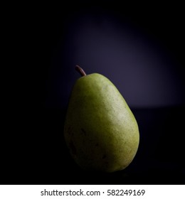 pear on a black background