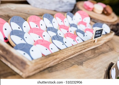 Pear tasty Blue and pink colored Cookies with face of fox on wooden desk