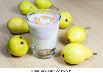 Pear yoghurt in a glass and raw fruits