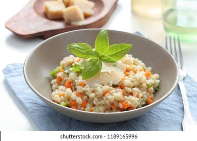 Pearl barley risotto with Parmesan cheese and basil
