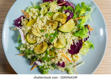 Pearl barley salad with zucchini and colorful vegetables