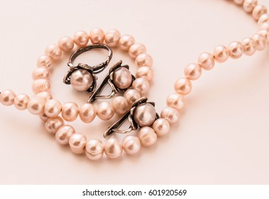 Pearl beads with jewelry earrings and a ring