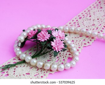 Pearl Bracelet and Pink Daisy