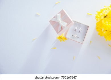 Pearl earrings in the gift box with yellow flowers