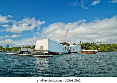 PEARL HARBOR, HAWAII - DECEMBER 28,2015: Visitors look out from the memorial sited over the wreck of the battleship USS Arizona, which sank during the Japanese attack with the loss of 1177 lives.