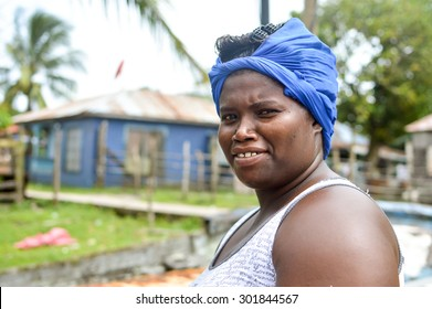 Pearl Lagoon, Nicaragua - July 16, 2015:  Beautiful Creole woman smiles for the camera on July 16, 2015 in Pearl Lagoon. She works at the station where the freshly caught crabs are prepared for export