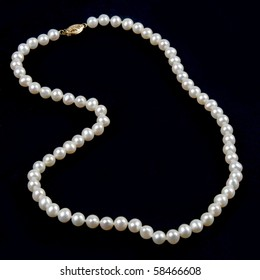 Pearl necklace against a dark background