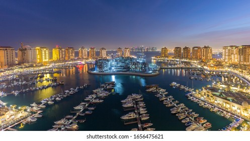 The Pearl on Feb 10, 2020 in Doha.it is an artificial island in Qatar. View of the Marina and residential buildings in Porto Arabia in Doha, Qatar, Middle East