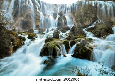 The Pearl Shoal Waterfall is famous waterfall in Jiuzhaigou, China. Waterfall in Jiuzhaigou known for multi-level structure and color.