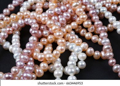 Pearl strands on black bakground