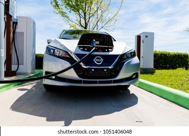 Pearland, Texas - March 21, 2018: New 2018 Nissan Leaf electric car plugged in to charge battery at the EVgo charging station
